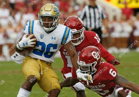 Tre Brown, Patrick Fields, Martell Irby. Oklahoma safety Patrick Fields (10) and cornerback Tre Brown (6) move in to tackle UCLA running back Martell Irby (26) in the second half of an NCAA college football game in Norman, Okla., . Oklahoma won 49-21