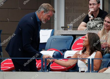 Stock Image of Irish actor Pierce Brosnan (L) and US actress Vanessa Williams (R) as Naomi Osaka of Japan plays Serena Williams of the US during the women's final on the thirteenth day of the US Open Tennis Championships the USTA National Tennis Center in Flushing Meadows, New York, USA, 08 September 2018. The US Open runs from 27 August through 09 September.
