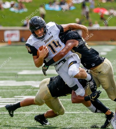 Towson quarterback Tom Flacco (14) is tackled by Wake Forest linebackers Demetrius Kemp, left, and Justin Strnad in the first half of a NCAA college football game in Winston-Salem, N.C