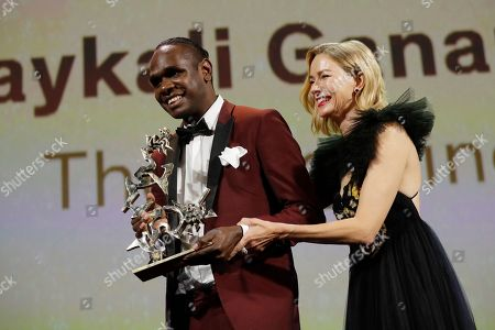 Naomi Watts, Baykali Ganambarr. Jury member Naomi Watts, right, presents Baykali Ganambarr with the Best Young Actor award for 'The Nightingale' at the closing ceremony of the 75th edition of the Venice Film Festival in Venice, Italy