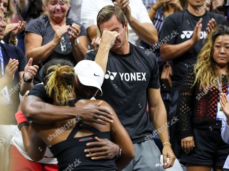 Stock Photo of Naomi Osaka celebrates her victory in the women's final. Her coach Aleksandar Bajin seen crying