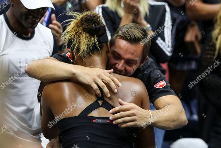 Naomi Osaka celebrates her victory in the women's final with her coach Aleksandar Bajin