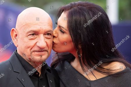 British actor Sir Ben Kingsley (L) is kissed by his wife Daniela Lavender as they arrive on the red carpet prior to the premiere of 'Operation Finale' during the 44th Deauville American Film Festival, in Deauville, France, 08 September 2018. The festival runs from 31 August to 11 September.