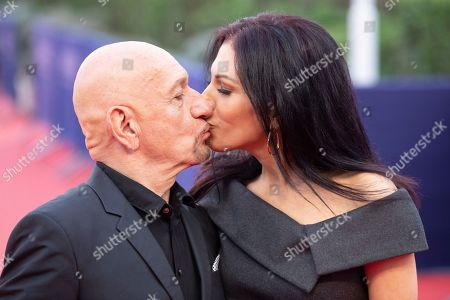 British actor Sir Ben Kingsley (L) and his wife Daniela Lavender kiss as they arrive on the red carpet prior to the premiere of 'Operation Finale' during the 44th Deauville American Film Festival, in Deauville, France, 08 September 2018. The festival runs from 31 August to 11 September.