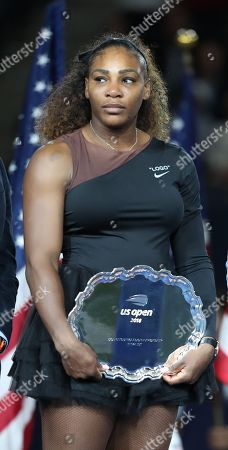 An emotional Serena Williams lifts the Runner's Up plate following her defeat in the Women's Singles final in the presentation ceremony