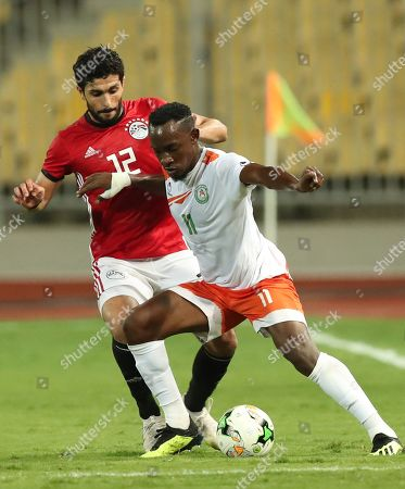 Egyptian  player Ayman Ashraf  (L)  in action against  Niger player Wonkoye Amadou (R) during the African Nations Cup qualifier game between Egypt and Niger at Borg El Arab Stadium in Alexandria, Egypt, 08 September 2018.