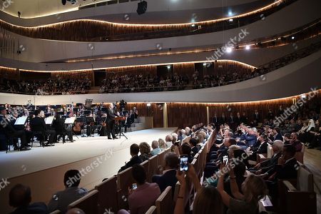 Russian President Vladimir Putin (C) delivers a speech during the opening the Moscow Concert Hall 'Zaryadye' in the new park, built in the historic center of the city, next to the Kremlin and Red Square in Moscow, Russia, 08 September 2018. The new concert hall designed for 1600 seats. A famous Japanese specialist, director of 'Nagata Acoustics' company Yasuhisa Toyota, was drafted for create acoustics in Zaryadye.
