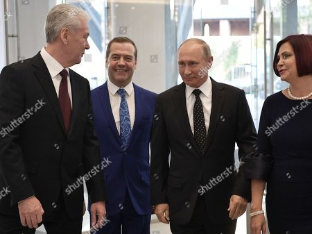 Moscow Mayor Sergei Sobyanin (L), Russia's Prime Minister Dmitry Medvedev (2-L), Russia's President Vladimir Putin (2-R) and Olga Zhukova (R), general director of the Zaryadye Concert Hall, attend the opening the Moscow Concert Hall 'Zaryadye' in the new park, built in the historic center of the city, next to the Kremlin and Red Square in Moscow, Russia, 08 September 2018. The new concert hall designed for 1600 seats. A famous Japanese specialist, director of 'Nagata Acoustics' company Yasuhisa Toyota, was drafted for create acoustics in Zaryadye.