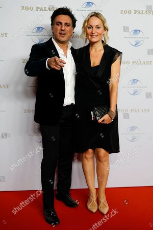 Iranian-German celebrity hair stylist Shan Rahimkhan (L) and his wife Claudia arrive on the red carpet of the gala on the occasion of the 100th birthday of German film producer Artur Brauner in Berlin, Germany, 08 September 2018. Artur 'Atze' Brauner celebrated his 100th birthday on 01 August 2018 in the company of his family. With the gala the film world wants to celebrate the producer officially in the Zoo Palast cinema. Around 700 invited guests from all over Europe were expected, including many companions and prominent actors.