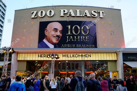 People watch the arrival of celebrities in front of the Zoo Palast cinema, venue of a gala on the occasion of the 100th birthday of German film producer Artur Brauner in Berlin, Germany, 08 September 2018. Artur 'Atze' Brauner celebrated his 100th birthday on 01 August 2018 in the company of his family. With the gala, the film world wants to celebrate the producer officially in the Zoo Palast cinema. Around 700 invited guests from all over Europe are expected, including many companions and prominent actors.