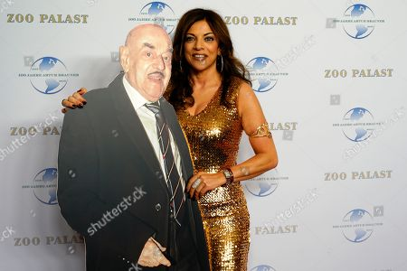 Alice Brauner (R) poses with a cardboard standup depicting her father Artur Brauner on the red carpet of a gala on the occasion of the 100th birthday of German film producer Artur Brauner in Berlin, Germany, 08 September 2018. Artur 'Atze' Brauner celebrated his 100th birthday on 01 August 2018 in the company of his family. With the gala, the film world wants to celebrate the producer officially in the Zoo Palast cinema. Around 700 invited guests from all over Europe are expected, including many companions and prominent actors.
