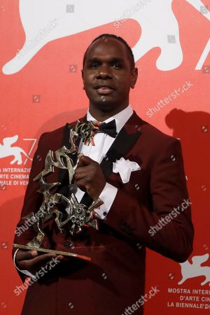 Baykali Ganambarr holds the Best Young Actor award for 'The Nightingale' at the awards photo call of the 75th edition of the Venice Film Festival in Venice, Italy