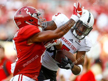Alabama defensive back Patrick Surtain II (2) breaks up a pass in the end zone intended for Arkansas State wide receiver Jonathan Adams Jr. (9) during the second half of an NCAA college football game, in Tuscaloosa, Ala. Alabama won 57-7