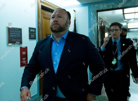 Ben Jealous, Bernie Sanders. Alex Jones, the right-wing conspiracy theorist, walks the corridors of Capitol Hill, talking to reporters, after listening to Facebook COO Sheryl Sandberg and Twitter CEO Jack Dorsey testify before the Senate Intelligence Committee on 'Foreign Influence Operations and Their Use of Social Media Platforms' on Capitol Hill, in Washington. Twitter's permanent ban of conspiracy-monger Alex Jones on Thursday again underscored the difficulty many social-media services face in trying to consistently apply their rules against harassment and other bad behavior