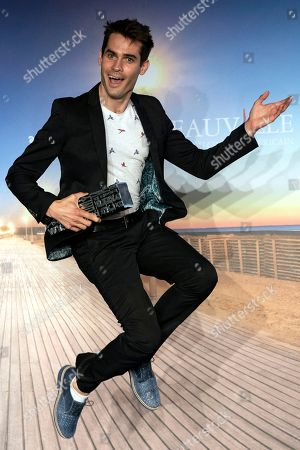 US director Jim Cummings reacts with his grand prize trophy during a photocall of the winners of the 44th Deauville American Film Festival, in Deauville, France, 08 September 2018. The festival runs from 31 August to 11 September.