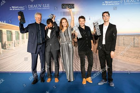 (L-R) This year's winners, for the public prize US director Marc Turtletaub, the Louis Roederer Foundation prize US director Jeremiah Zagar, the jury prize US director Jordana Spiro, the jury prize British director Bart Layton and the grand prize Jim Cummings pose with their trophies during a photocall of the winners of the 44th Deauville American Film Festival, in Deauville, France, 08 September 2018. The festival runs from 31 August to 11 September.