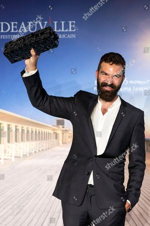 Stock Picture of US director Jeremiah Zagar poses with his Louis Roederer Foundation prize trophy during a photocall of the winners of the 44th Deauville American Film Festival, in Deauville, France, 08 September 2018. The festival runs from 31 August to 11 September.