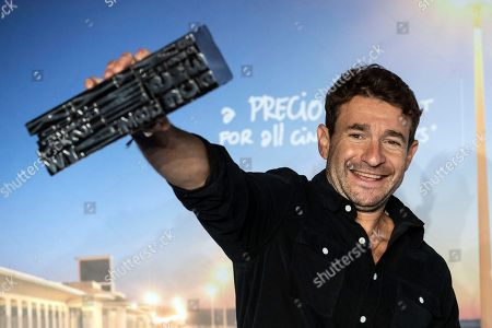 British director Bart Layton poses with his jury prize trophy during a photocall of the winners of the 44th Deauville American Film Festival, in Deauville, France, 08 September 2018. The festival runs from 31 August to 11 September.