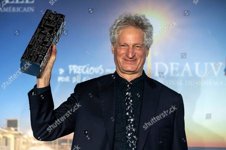US director Marc Turtletaub poses with his public prize trophy during a photocall of the winners of the 44th Deauville American Film Festival, in Deauville, France, 08 September 2018. The festival runs from 31 August to 11 September.