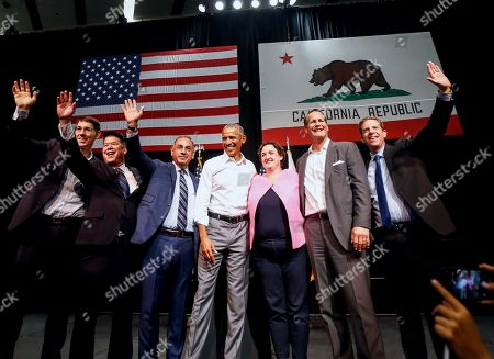 President Barack Obama, center, with congressional candidates, from left, Josh Harder, TJ Cox, Gil Cisneros, Katie Porter, Harley Rouda and Mike Levin wave to supporters as Obama campaigns in support of California congressional candidates, in Anaheim, Calif