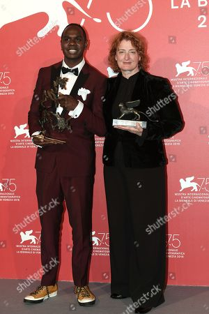 Baykali Ganambarr and Jennifer Kent pose with the the ' Marcello Mastroianni ' Award for Best New Young Actor or Actress and the Special Jury Prize for 'The Nightingale'
