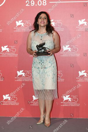 Stock Image of Soudade Kaadan poses with the Lion Of The Future - 'Luigi De Laurentiis' Venice Award for a Debut Film for 'The Day I Lost My Shadow