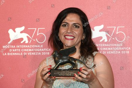 Soudade Kaadan poses with the Lion Of The Future - 'Luigi De Laurentiis' Venice Award for a Debut Film for 'The Day I Lost My Shadow