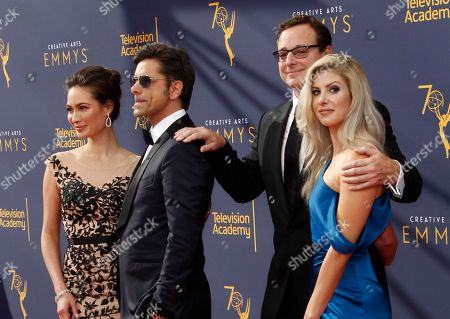 US actors John Stamos (2-L) and his wife Caitlin McHugh (L) along with Kelly Rizzo (R) and Bob Saget (2-R) arrive for the 2018 Creative Arts Emmy Awards at the Microsoft Theater in Los Angeles, California, USA, 08 September 2018. The Creative Arts Emmy Awards honor excellence in Television technical categories such as makeup, casting direction, costume design, editing and cinematography. The 70th Primetime Emmy Awards Ceremony will take place on 17 September 2018.