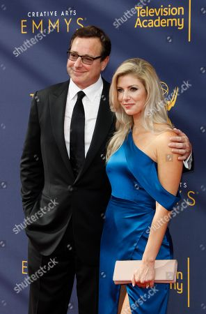 Kelly Rizzo (R) and Bob Saget (2-R) arrive for the 2018 Creative Arts Emmy Awards at the Microsoft Theater in Los Angeles, California, USA, 08 September 2018. The Creative Arts Emmy Awards honor excellence in Television technical categories such as makeup, casting direction, costume design, editing and cinematography. The 70th Primetime Emmy Awards Ceremony will take place on 17 September 2018.