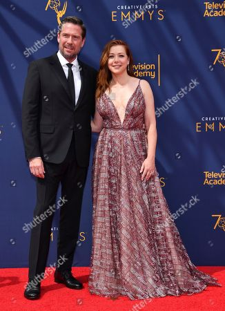 Alexis Denisof, Alyson Hannigan. Alexis Denisof, left, and Alyson Hannigan arrive at night one of the Television Academy's 2018 Creative Arts Emmy Awards at the Microsoft Theater, in Los Angeles