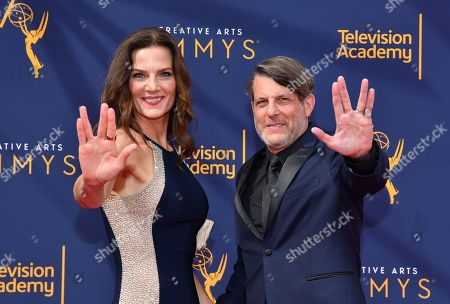 Stock Picture of Terry Farrell, Adam Nimoy. Terry Farrell, left and Adam Nimoy give the Vulcan salute while arriving at night one of the Television Academy's 2018 Creative Arts Emmy Awards at the Microsoft Theater, in Los Angeles