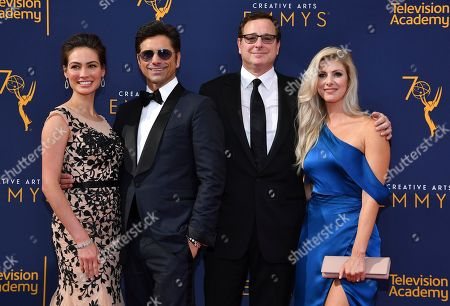 John Stamos, Caitlin McHugh, Bob Saget, Kelly Rizzo. Caitlin McHugh, from left, John Stamos, Bob Saget and Kelly Rizzo arrive at night one of the Television Academy's 2018 Creative Arts Emmy Awards at the Microsoft Theater, in Los Angeles