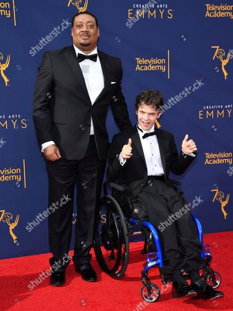 Cedric Yarbrough, Micah Fowler. Cedric Yarbrough, left, and Micah Fowler arrive at night one of the Television Academy's 2018 Creative Arts Emmy Awards at the Microsoft Theater, in Los Angeles