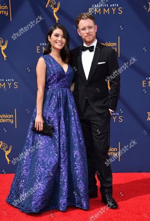 Christian Sprenger, Jessica Lu. Jessica Lu, left, and Christian Sprenger arrive at night one of the Television Academy's 2018 Creative Arts Emmy Awards at the Microsoft Theater, in Los Angeles