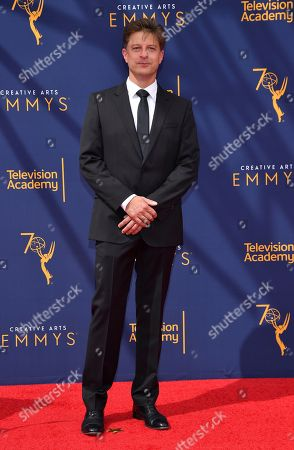 Cyrille Aufort arrives at night one of the Television Academy's 2018 Creative Arts Emmy Awards at the Microsoft Theater, in Los Angeles