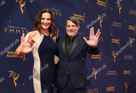 Terry Farrell, Adam Nimoy. Terry Farrell, left, and Adam Nimoy arrive at night one of the Television Academy's 2018 Creative Arts Emmy Awards at the Microsoft Theater, in Los Angeles