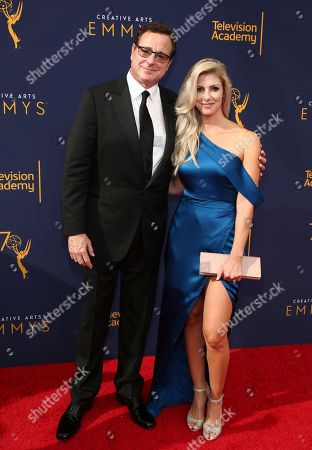 Bob Saget, Kelly Rizzo. Bob Saget, left, and Kelly Rizzo arrive at night one of the Television Academy's 2018 Creative Arts Emmy Awards at the Microsoft Theater, in Los Angeles