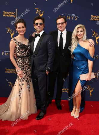 Caitlin McHugh, John Stamos, Bob Saget, Kelly Rizzo. Caitlin McHugh, from left, John Stamos, Bob Saget and Kelly Rizzo arrive at night one of the Television Academy's 2018 Creative Arts Emmy Awards at the Microsoft Theater, in Los Angeles
