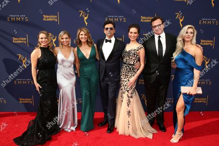 Andrea Barber, Candace Cameron Bure, Lori Loughlin, John Stamos, Caitlin McHugh, Bob Saget, Kelly Rizzo. Andrea Barber, from left, Candace Cameron Bure, Lori Loughlin, John Stamos, Caitlin McHugh, Bob Saget and Kelly Rizzo arrive at night one of the Television Academy's 2018 Creative Arts Emmy Awards at the Microsoft Theater, in Los Angeles