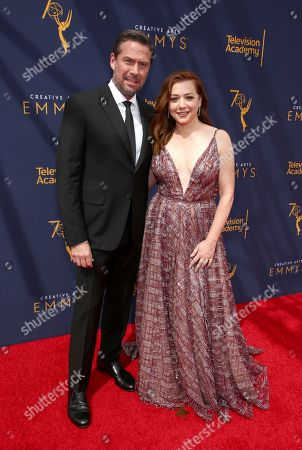 Alyson Hannigan, Alexis Denisof. Alexis Denisof, left, and Alyson Hannigan arrive at night one of the Television Academy's 2018 Creative Arts Emmy Awards at the Microsoft Theater, in Los Angeles