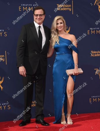 Bob Saget, Kelly Rizzo. Bob Saget, left, and Kelly Rizzo arrive at night one of the Creative Arts Emmy Awards at The Microsoft Theater, in Los Angeles
