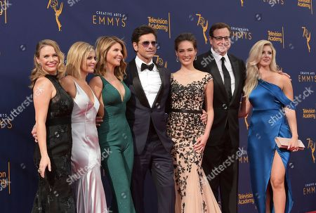 Andrea Barber, Candace Cameron Bure, Lori Loughlin, John Stamos, Caitlin McHugh, Bob Saget, Kelly Rizzo. Andrea Barber, from left, Candace Cameron Bure, Lori Loughlin, John Stamos, Caitlin McHugh, Bob Saget and Kelly Rizzo arrive at night one of the Creative Arts Emmy Awards at The Microsoft Theater, in Los Angeles