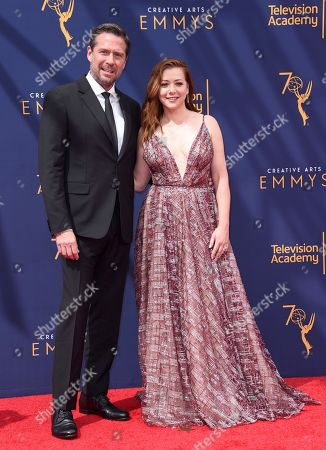 Alexis Denisof, Alyson Hannigan. Alexis Denisof, left, and Alyson Hannigan arrive at night one of the Creative Arts Emmy Awards at The Microsoft Theater, in Los Angeles