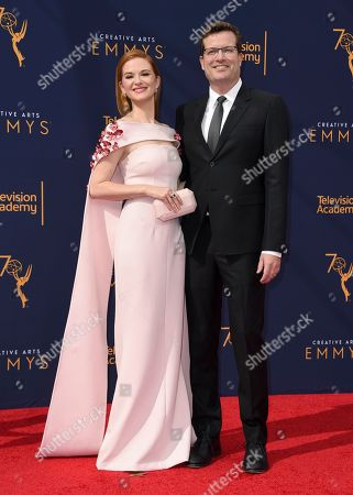 Stock Image of Sarah Drew, Peter Lanfer. Sarah Drew, left, and Peter Lanfer arrive at night one of the Creative Arts Emmy Awards at The Microsoft Theater, in Los Angeles