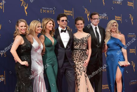 Andrea Barber, Candace Cameron Bure, Lori Loughlin, John Stamos, Caitlin McHugh, Bob Saget, Kelly Rizzo. Andrea Barber, from left, Candace Cameron Bure, Lori Loughlin, John Stamos, Caitlin McHugh, Bob Saget, and Kelly Rizzo arrive at night one of the Creative Arts Emmy Awards at The Microsoft Theater, in Los Angeles