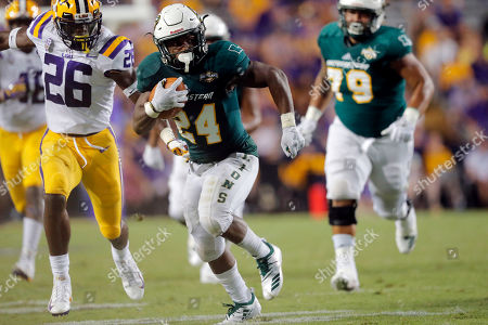 Southeastern Louisiana running back Darren Johnson (24) carries against LSU safety John Battle (26) in the second half of an NCAA college football game in Baton Rouge, La., . LSU won 31-0