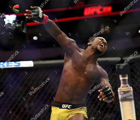 Abdul Razak Alhassan throws his mouthpiece in celebration after knocking out Niko Price in their welterweight mixed martial arts bout at UFC 228, in Dallas