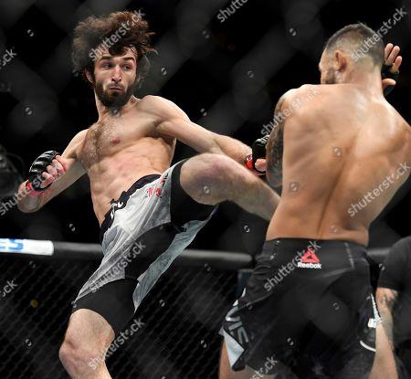 Zabit Magomedsharipov, left, kicks Brandon Davis during their featherweight mixed martial arts bout at UFC 228, in Dallas