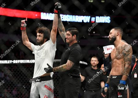 Zabit Magomedsharipov, left, is acknowledged as the winner by submission over Brandon Davis, right, in their featherweight mixed martial arts bout at UFC 228, in Dallas