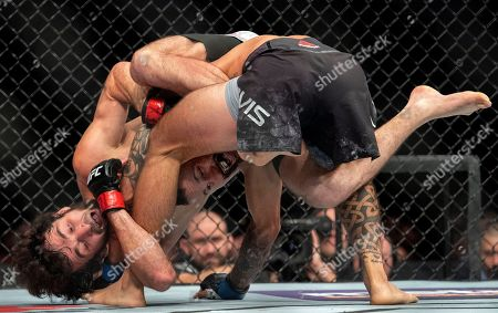 Zabit Magomedsharipov, left, is flipped over by Brandon Davis during their featherweight mixed martial arts bout at UFC 228, in Dallas